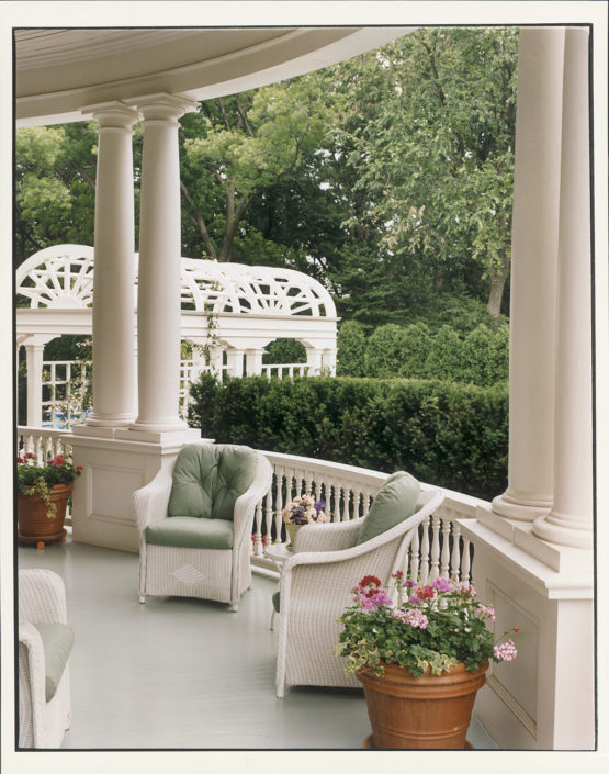 SUMMER SETTING. The classic semicircular veranda shown with white wicker furniture, coupled with a sage green wood floor that was completely redone during the six-month renovation project before the Gores moved in. Pictured also is the new pergola that leads to the pool installed by the Quayles during their stay. Number One Observatory Circle, the official home and residence of the Vice President of the United States. (Photographer: Oberto Gili). Text credit: Charles Denyer.