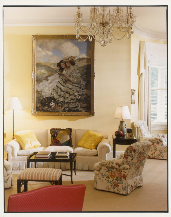 LIVING ROOM LUXURY. A James Shannon painting, On the Dunes, hangs in the Gores' living room that's accented with brightly colored fabrics, ivory curtains, a Pembroke table, a twentieth-century bowl, and other furnishings. The crystal chandelier was already installed in the home. Number One Observatory Circle, the official home and residence of the Vice President of the United States. (Photographer: Oberto Gili). Text credit: Charles Denyer.