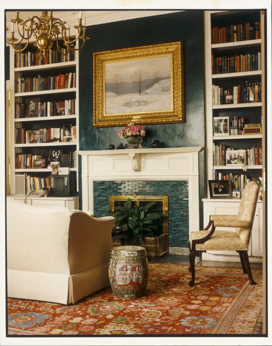 HISTORY ON HAND. Top shelves in the bookcases contain various publications on vice presidents of the past, a tradition started by Joan Mondale as she formally dedicated the room as the vice-presidential library. Finished with a distinct glazed and lacquered peacock blue, this unique area on the first floor of the residence has been known over the years as the library, sitting room, or den. Number One Observatory Circle, the official home and residence of the Vice President of the United States. (Photographer: Oberto Gili). Text credit: Charles Denyer.
