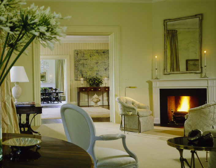 FRANK & LYNNE. Famed Designer Frank Randolph of Georgetown and Mrs. Cheney worked closely together while decorating the residence, which included tones of celadon highlighting the living room that contained personal pieces collected over the years by the Cheneys. Mrs. Cheney reached out to Randolph because she admired his open, elegant, and comfortable style of design. Number One Observatory Circle, the official home and residence of the Vice President of the United States. (Photographer: Durston Saylor for Architectural Digest, November 2001). Text credit: Charles Denyer.