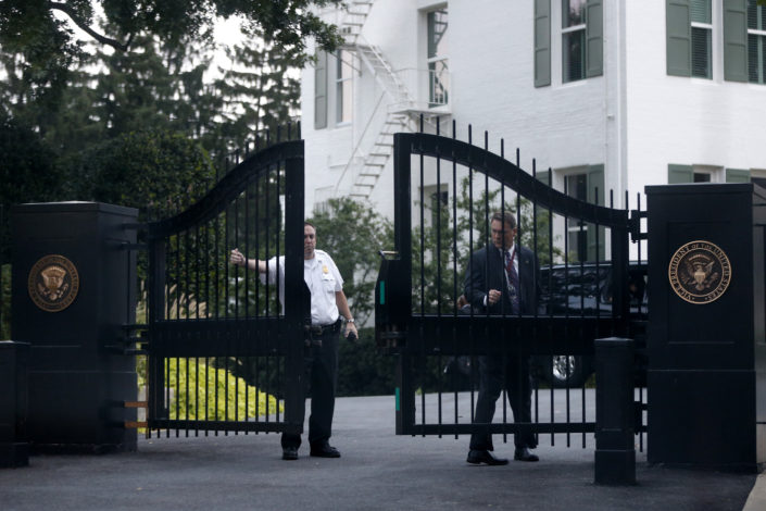 SERIOUS SECURITY: A member of the Secret Service's Uniformed Division closes a gate to the vice president's residence at the US Naval Observatory. Number One Observatory Circle, the official home and residence of the Vice President of the United States, built in 1893 at a cost of $20,000. (Credit: (AP Photo/Charles Dharapak, ID: 742076799073). Text credit: Charles Denyer.