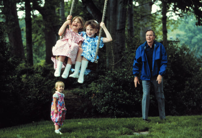 Swing Time: Vice President Bush with 3 of his grandchildren including Barbara and Jenna Bush on the lawn at the Naval Observatory Vice President House in Washington DC. Photographer: David Valdez. Text Credit: Charles Denyer.